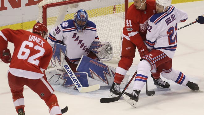 Detroit Red Wings left wing Thomas Vanek takes a shot against New York Rangers goalie Henrik Lundqvist during first period action Sunday, Jan. 22, 2017 at Joe Louis Arena in Detroit Michigan.