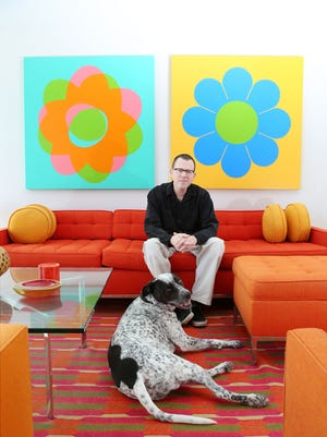 Artist Jim Isermann in his Palm Springs studio with his dog Happy.