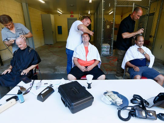 Randolph police officers shave their heads in support