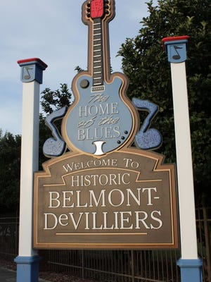 A sign welcomes people to the historic Belmont-DeVilliers neighborhood.