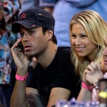 Enrique Iglesias, left, and his wife Anna Kournikova, second from left, watch the game between the Miami Heat and the Cleveland Cavaliers of a basketball game in Miami, Thursday, Feb. 1, 2007. The Heat won, 92-89. (AP Photo/Alan Diaz) ORG XMIT: AAA109