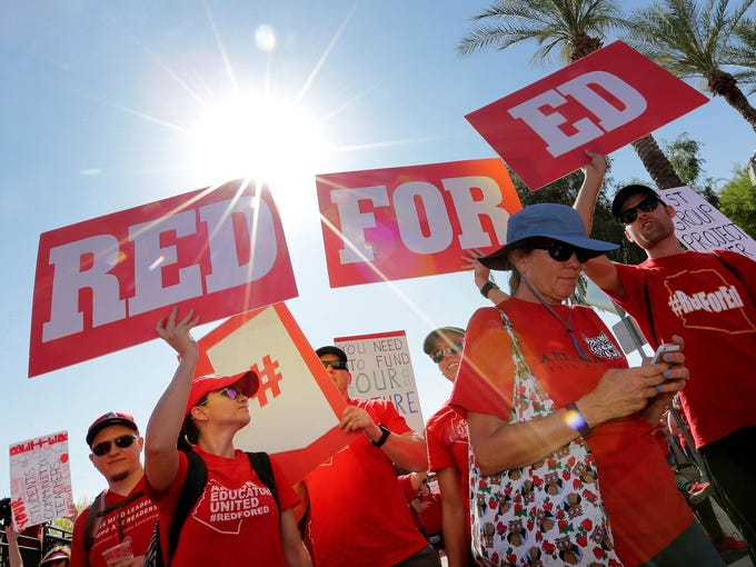 Teachers rally outside the Capitol, Friday, April 27,