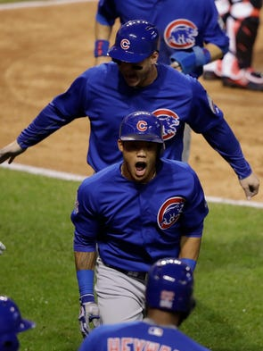 Chicago Cubs' Addison Russell celebrates after hitting