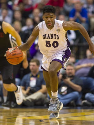 Ben Davis' Aaron Henry (50) races the ball upcourt during the first half of the IHSAA Class 4A boys' state basketball championship against Fort Wayne North Side in Indianapolis pm Saturday.