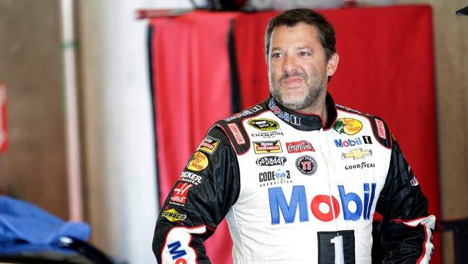 Driver Tony Stewart reacts during practice for the Brickyard 400 Sprint Cup series auto race at the Indianapolis Motor Speedway in Indianapolis, July 26, 2014.