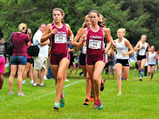 Chiles seniors Alexandra Wallace and Emma Tucker pace the Timberwolves during Saturday's Alligator Lake Invitational in Lake City. Tucker won the race by a nose, while Wallace finished fourth.