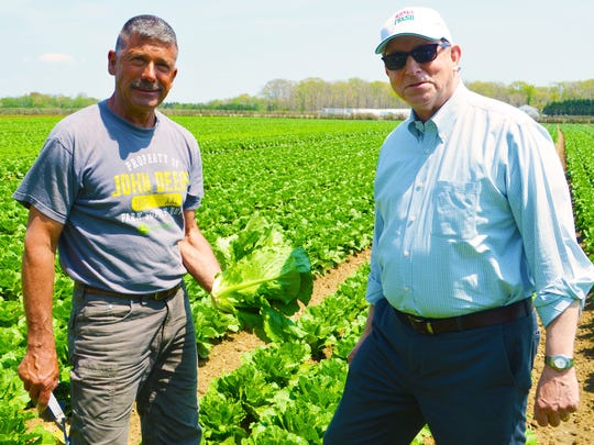 Eric Hensel, of Hensel Farms in Atlantic County, and New Jersey Secretary of Agriculture Douglas H. Fisher out in a field of romaine lettuce.