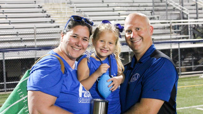 Middletown defensive coordinator Zach Blum, shown here with his wife Casey and daughter Sophie, has been named the Cavaliers' new head football coach.