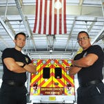 Firefighter/ EMT Charles Cummings and medic Lt. James Dean pose near one of the vehicles used by Brevard County Fire Rescue, which has won an Emergency Medical Services Provider of the Year Award. Photos taken at State 45 in Rockledge on U.S. 1.