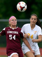 Concord's Gianna Rapposelli (left) concentrates on the ball as she goes against Caesar Rodney's Rachel Ewald in the second half of Caesar Rodney's 6-1 in a DIAA state tournament game at Caravel Wednesday.