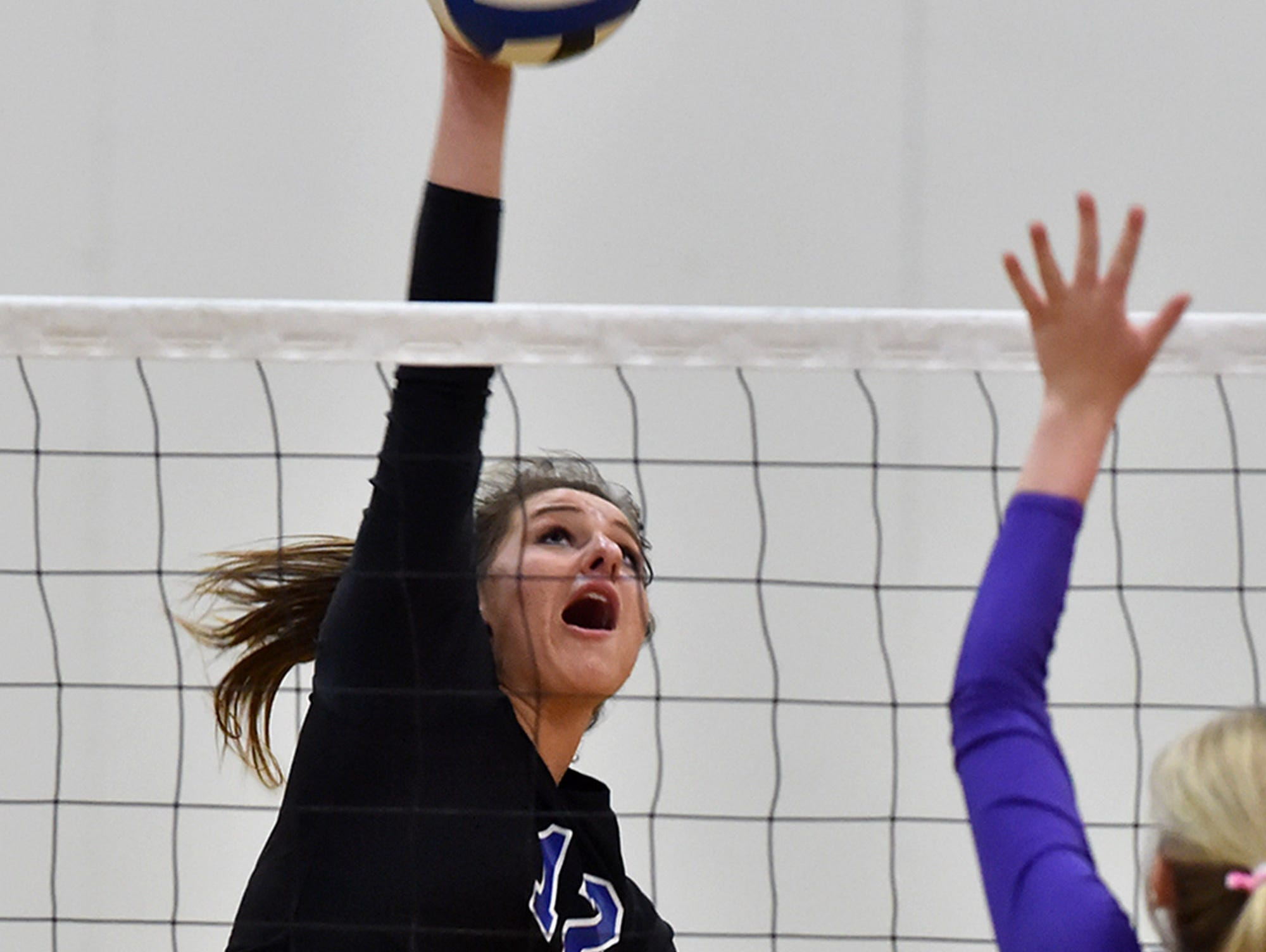 McQueen's Taylor Forte goes up for the spike again Spanish Springs in Thursday's game at McQueen.