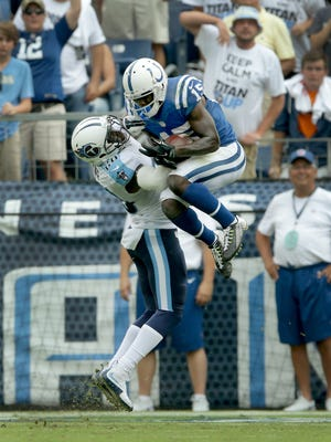 Indianapolis Colts wide receiver Phillip Dorsett (15) catches a touchdown pass as Tennessee Titans strong safety Marqueston Huff (28) defends in the fourth quarter of their game Sunday, September 27, 2015 at Nissan Stadium in Nashville TN.