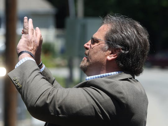 Rockaway Twp Mayor Michael G. Dachisen takes a photo