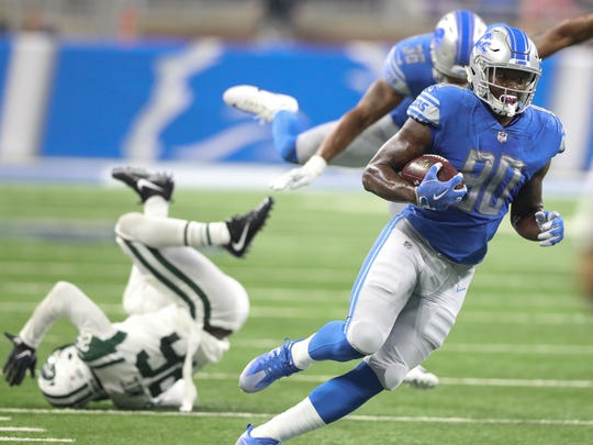 Michael Roberts runs for a first down against the Jets in the second quarter of the Lions' 16-6 exhibition win Aug. 19, 2017 at Ford Field.