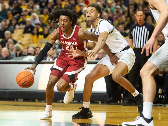 Alabama's John Petty Jr., left, drives past Missouri's Tray Jackson, right, during the first half of an NCAA college basketball game Saturday, March 7, 2020, in Columbia, Mo. (AP Photo/L.G. Patterson)