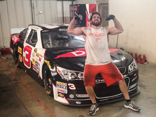 Paul Swan poses in front of a Richard Childress Racing practice car.