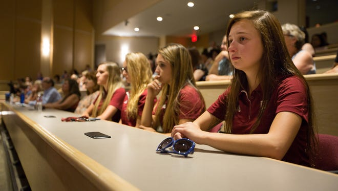 New Mexico State University equestrian athlete Kaitlin Nelson sits with teammates during a Board of Regents meeting Wednesday July 13, 2016. Chancellor Garrey Carruthers announced during the meeting that the equestrian team will not be funded next year.
