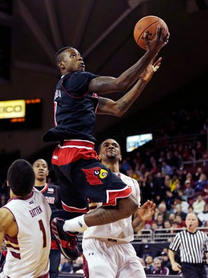 Louisville Cardinals guard Terry Rozier (0) drives to the basket against Boston College Eagles during the first half of an NCAA college basketball game in Boston, Wednesday Jan. 28, 2015. (AP Photo/Charles Krupa)