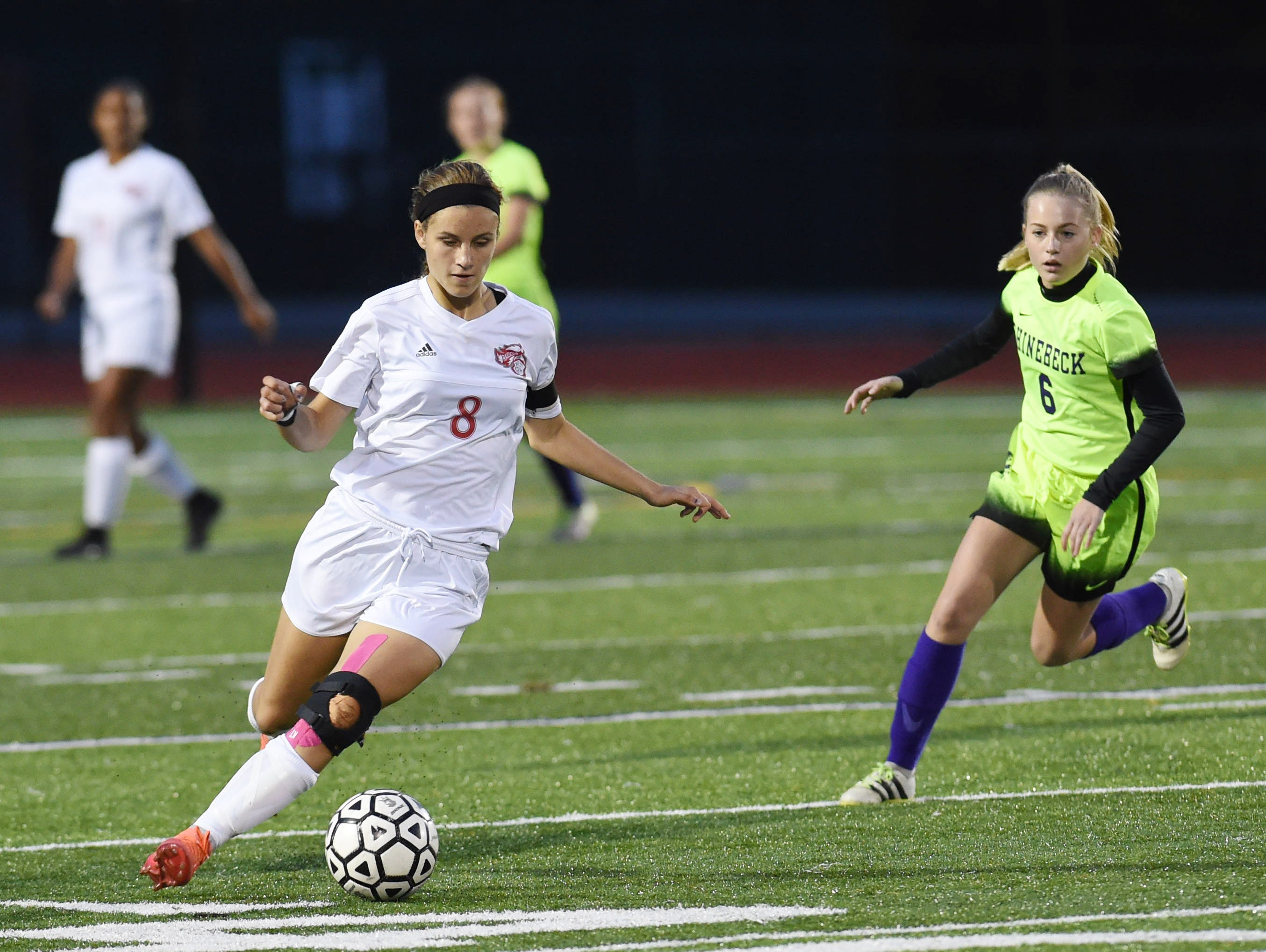 Red Hook's Isabell LaBarbera gains control of the ball as Rhinebeck's Summer Cruikshank closes in on her during Thursday's MHAL girls soccer championship at Franklin D. Roosevelt High School.