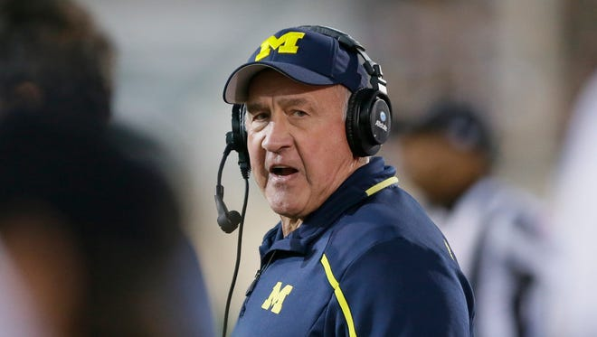 Michigan defensive coordinator Greg Mattison walks the sidelines during the second half of an NCAA college football game against Michigan State in East Lansing, Mich., Saturday, Oct. 25, 2014.