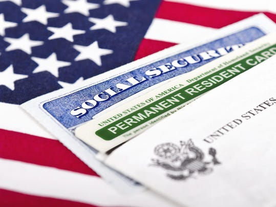 Social Security card and permanent resident on USA flag