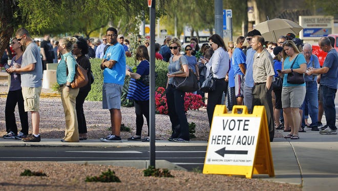 Voters wait in line to cast ballots in Arizona's presidential-preference election at Mountain View Lutheran Church in Phoenix on March 22, 2016.