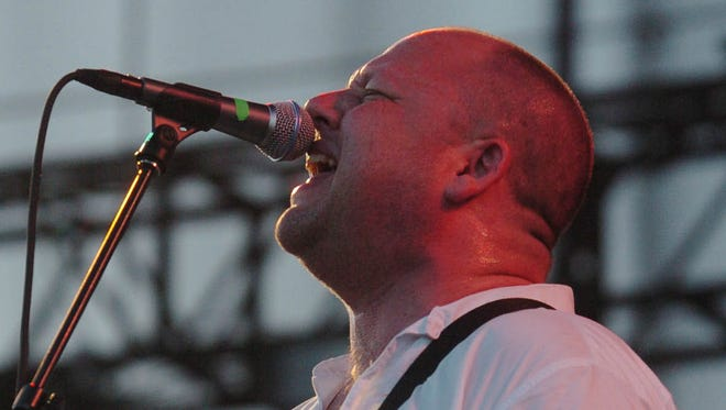 """The Pixies' """"Black Francis"""" aka Frank Black aka Charles Thompson sings at the Coachella Valley Music and Arts Festival in Indio."""