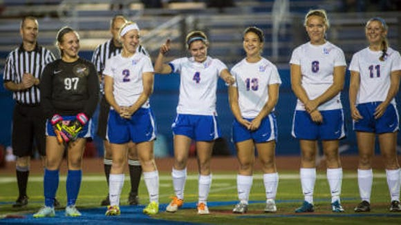 """Victoria Swiger is introduced during Spring Grove's """"blackout"""" game for melanoma awareness during Tuesday's girls' soccer game against New Oxford. (Clare Becker -- GameTimePA.com)"""