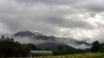 Clouds hang over the mountains a file photo of the Big Ivy area, near Barnardsville. In a current draft of a U.S. Forest Service plan, much of Big Ivy in the Pisgah National Forest would be opened to logging.