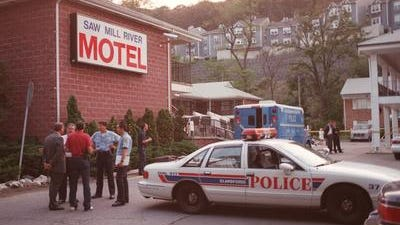 Westchester County and Elmsford Police investigate a double homicide scene at the Saw Mill River Motel in Elsmford, Sept. 5, 1995.