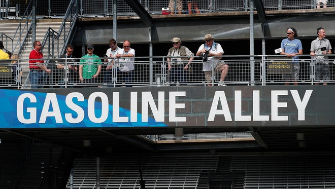Indianapolis 500 fans look over Gasoline Alley before the start of practice for the Indianapolis 500 at the Indianapolis Motor Speedway on Thursday, May 17, 2018.