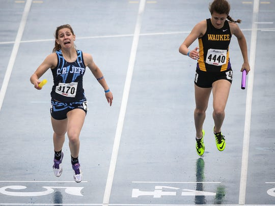 Cedar Rapids Jefferson's anchor Lucy Schneekloth edges out Waukee's Elma Vojic in the Girls 4x200 Meter Relay at the Drake Relays Friday April 24, 2015, at Drake University in Des Moines, Iowa.