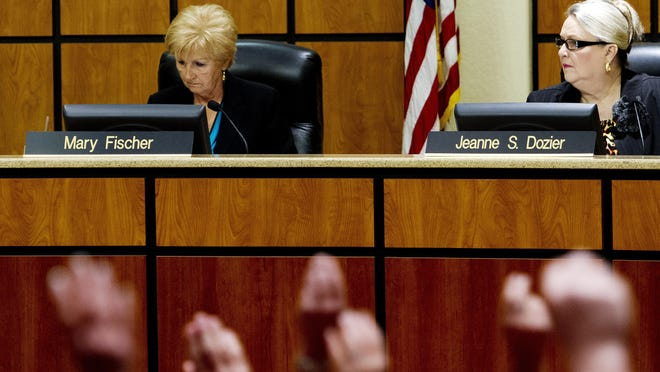 Lee County School Board members Mary Fischer, left and Jeanne Dozier listen to supporters of opting out of state standardized testing during a school board meeting last year. The board rescinded its vote to opt out after Fischer had a change of heart and called a special meeting.