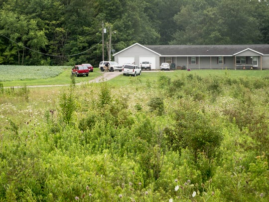 A Delaware County sheriff's car remains at the scene