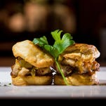 More than 70 restaurants across Orlando, including Soco, which created this pork belly biscuit, will participate in Magical Dining Month during September.