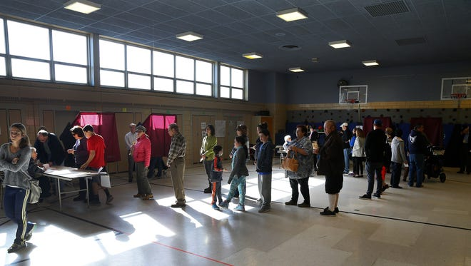Voters wait on line to cast their votes in the presidential election at Nutswamp School. Middletown,NJ.  Tuesday, November 8,  2016.  Noah K. Murray-Correspondent/Asbury Park Press ASB 1109 Middletown polling shots