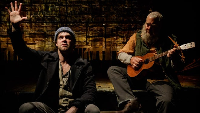 Geva's production of 'An Iliad' features Kyle Hatley, left, as the Poet, and Raymond Castrey, right, as the Musician.