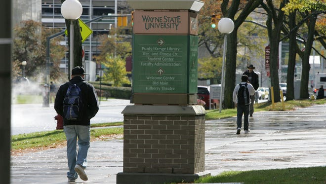 Students walk on the campus of Wayne State University in Detroit in this 2008 file photo.