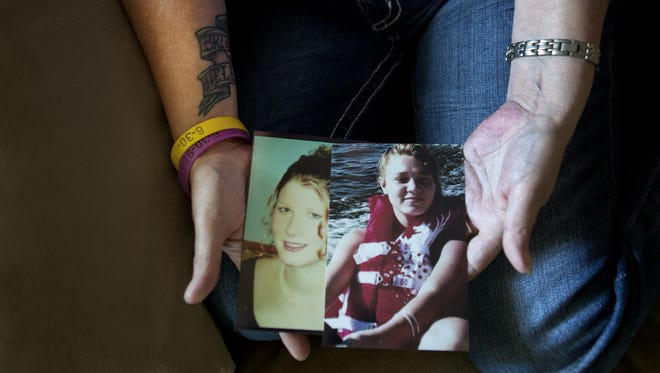 Dale Driscoll holds a photograph of her daughter, Helen Buchel, and granddaughter, Brittany Passalacqua, who were slain in their Geneva apartment in November 2009 by John Edward Brown.