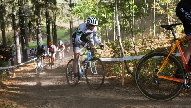 Riders in the elite men's race at the Ellison Park Cyclocross head uphill in the 2014 race.