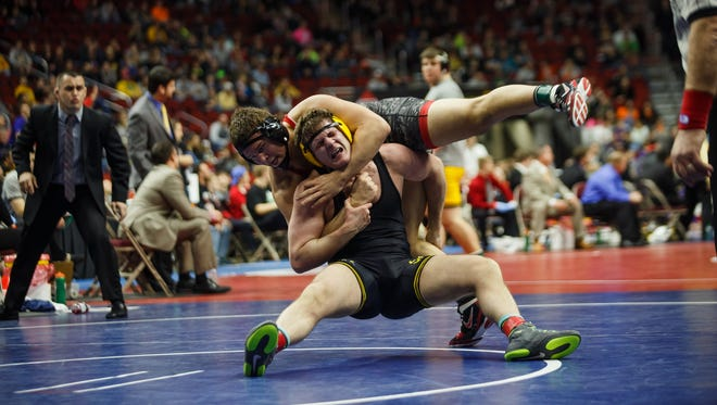 Southeast Polk's Ethan Andersen wrestles North Scott-Eldridge's Wyatt Wriedt during their 3A championship bout at the Iowa State Wrestling Championships in Des Moines on Saturday, Feb. 20, 2016.