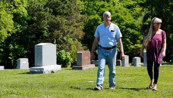 Steve and Darcy Weston stroll through Grand View Cemetery Monday, May 23, 2016, at 1510 N. Salisbury in West Lafayette. The couple are selling the cemetery.