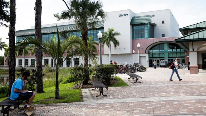 Students walk outside the library at FGCU on Wednesday, Aug. 24, 2016. The university will celebrate its 20th anniversary in 2017.