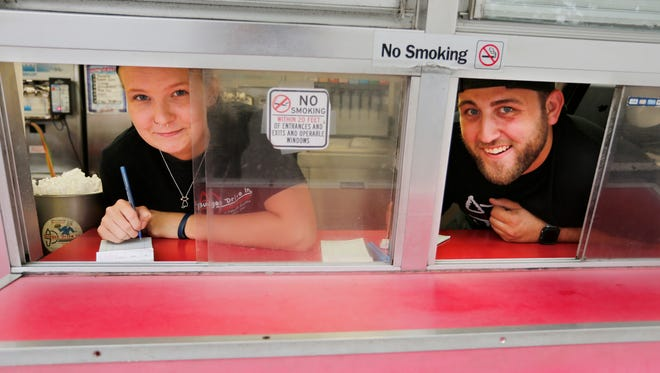 Tristen Lord and Tracy Medley at the front window Wednesday, July 12, 2017, at Budges Drive In, 1102 N. 14th Street in Lafayette. Lord, 21, has worked at the popular drive in for six summer season. For Medley, 21, it is his second season.