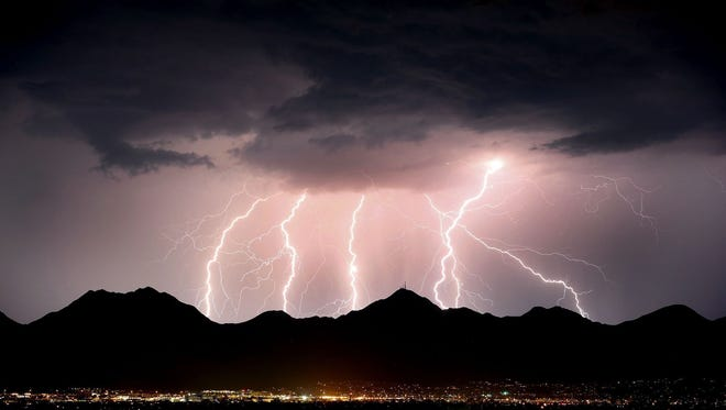 Lightning streaks across the desert sky over the McDowell Mountains near Scottsdale, Ariz. during a monsoon storm on July 15, 2017.  Lightning killed fewer Americans in 2017 than in any year on record.