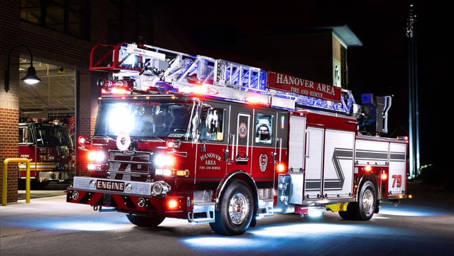 """In a composite """"light painting"""" image created from stitching together 16 images in which a LED light was shined across portions of the image, Hanover Area Fire & Rescue's new Engine 79-2 sits on display in front of the Clover Lane station, Thursday, June 22, 2018 in Penn Township. The new engine is expected to go into service in early August, according to Hanover Area Fire & Rescue Captain Kevin Adams."""