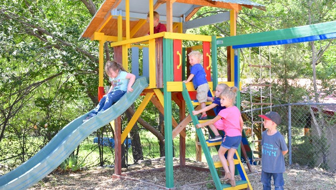 The updated treehouse at the playground is popular with kids of all ages.