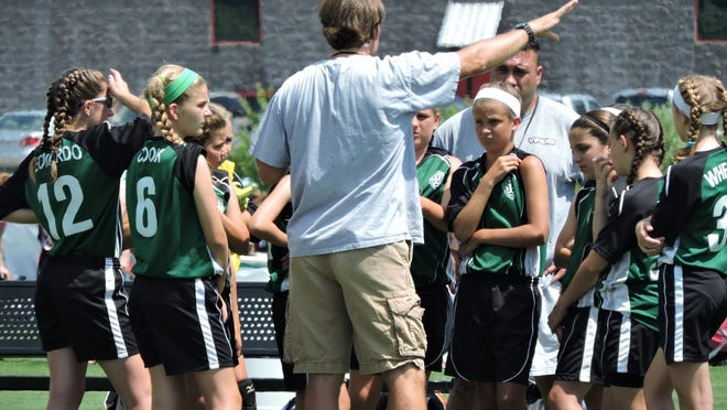Coaches Pat Cook and Nelson Furtado helped prepare the Dartmouth girls soccer team for the rigors of varsity back when they were youth players.