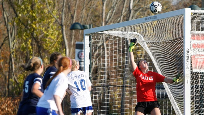 Pearl River goalie Lauren Galladher (1) watches a shot go over the goal during a sectional semi-final girls soccer game in Orangeburg on Thursday, Oct. 29, 2015.  Pearl River took the win 2-0.