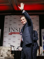 Texas Sen. Ted Cruz waves as he arrives to speak at